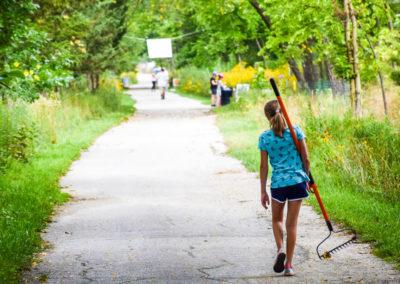 Woman holding rake